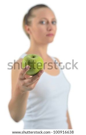 Young attractive athletic woman with green apple, isolated on white - stock photo