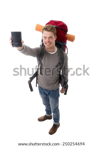 young attractive  backpacker tourist holding passport carrying backpack ready for travel and adventure on vacations and holidays isolated on white background