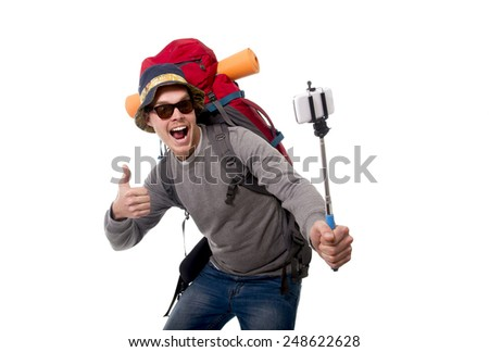 young attractive  backpacker tourist taking selfie photo with stick carrying backpack ready for travel and adventure on vacations route isolated on white background - stock photo