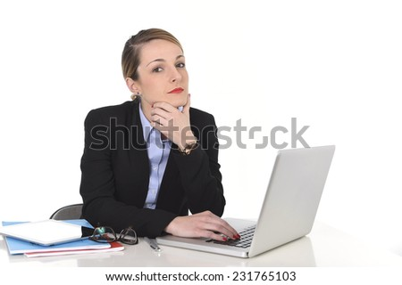young attractive blond businesswoman thinking and looking thoughtful, pensive and using imagination distraught while working on computer laptop at office desk