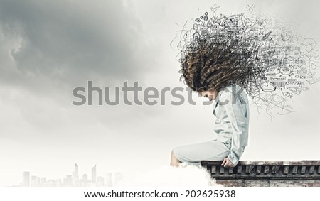 Young attractive blond girl against sketch background - stock photo
