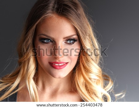 Young attractive blond hair woman portrait.