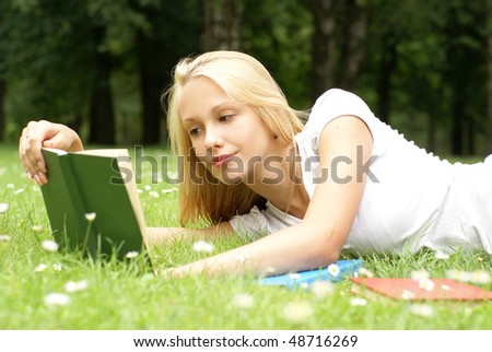 Young attractive blond is relaxing in the park