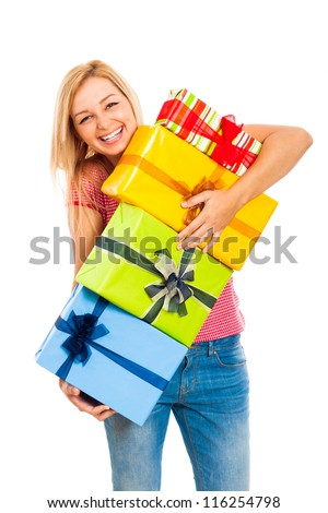 Young attractive blond laughing woman holding stack of colorful gift boxes, isolated on white background. - stock photo