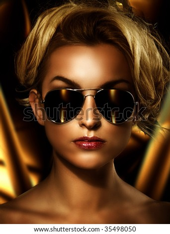 Young attractive blonde wearing stylish sunglasses - stock photo