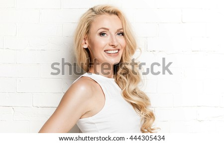 Young attractive blonde woman with long healthy hair. Beauty portrait. - stock photo