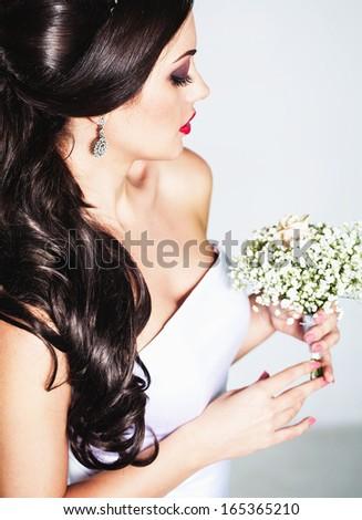 Young attractive bride portrait in studio - stock photo
