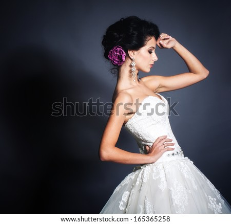 Young attractive bride portrait in studio