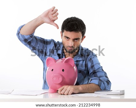 young attractive broke man worried in stress feeling sad hugging empty pink piggy bank in bad financial situation concept wearing casual shirt isolated on white background - stock photo