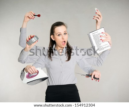 young attractive brunette with six arms multitasking her work - stock photo