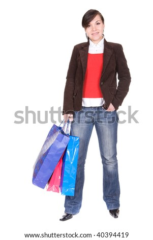 young attractive brunette woman with shopping bags. over white background