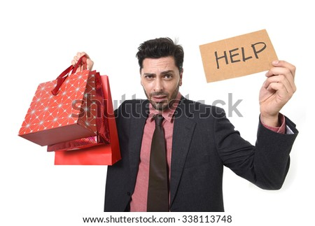 young attractive business man in stress holding lot of shopping bags and help sign looking tired bored and worried after expending too much money on gifts and presents - stock photo