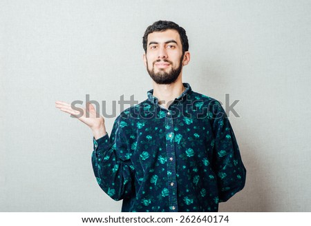 young attractive business man showing blank copy space above palm hand for client to add product or text, looking happy and excited - stock photo