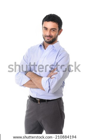 young attractive business man standing in corporate portrait isolated on white background smiling with folded arms in shirt and suit trousers - stock photo