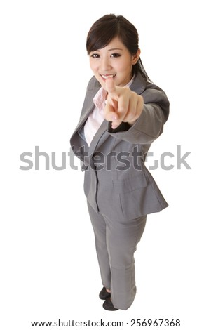 Young attractive business woman of Asianpoint at you, full length portrait on white. - stock photo
