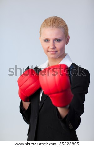 Young Attractive business woman with Boxing gloves with focus on person