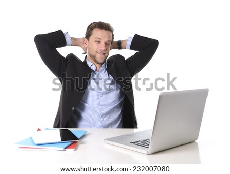 young attractive businessman happy and hectic at office work sitting at computer desk satisfied and smiling relaxed leaning on chair isolated on white background