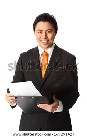 Young attractive businessman wearing a suit and tie, holding a folder. White background.