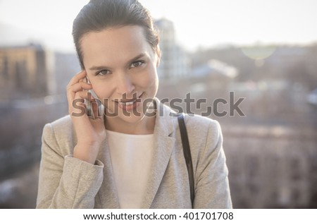 Young attractive businesswoman during business call - stock photo