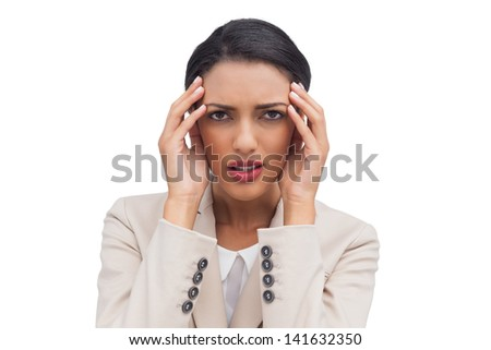 Young attractive businesswoman having a headache on white background - stock photo