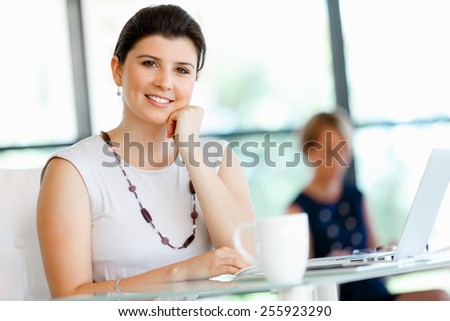 Young attractive businesswoman in office
