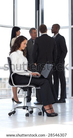 Young attractive businesswoman in office working 2 - stock photo