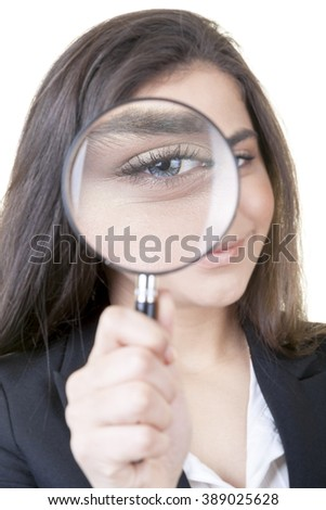 Young attractive businesswoman is searching for new opportunities against isolated white background. - stock photo