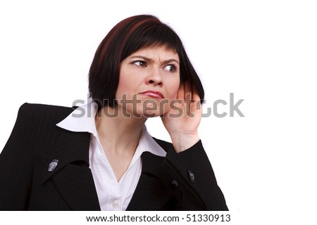 Young attractive businesswoman listening gossip isolated on white. Beautiful business female eavesdropping. Business woman trying to hearing the sound around her.