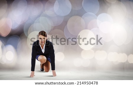 Young attractive businesswoman standing in start position - stock photo