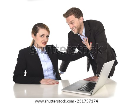 young attractive businesswoman suffering sexual harassment and abuse of colleague or office flirting in inappropriate behavior at work with excessive familiarity in work relationship concept - stock photo