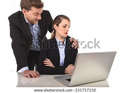 young attractive businesswoman suffering sexual harassment and abuse of colleague or office boss touching her in inappropriate behavior at work with excessive familiarity in work relationship concept - stock photo