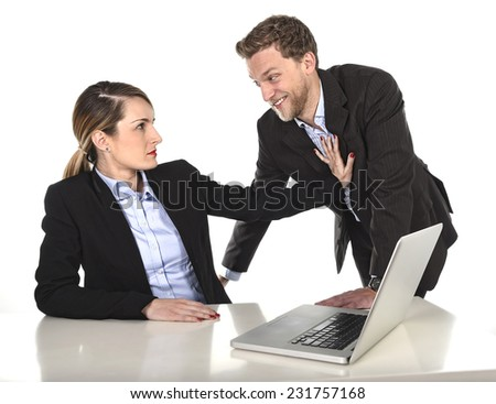 young attractive businesswoman suffering sexual harassment and abuse of colleague or office boss approaching in inappropriate behavior at work with excessive familiarity in work relationship concept - stock photo
