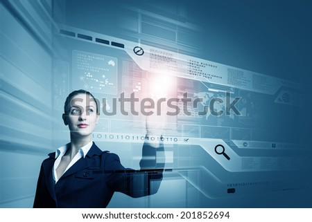 Young attractive businesswoman touching icon of digital screen - stock photo