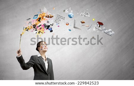 Young attractive businesswoman with paint brush in hand