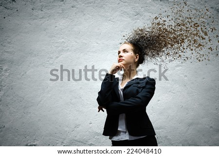 Young attractive businesswoman with thoughts above her head