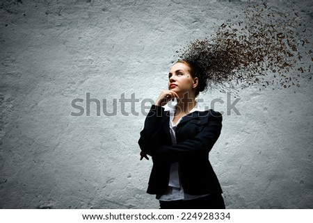 Young attractive businesswoman with thoughts above her head - stock photo