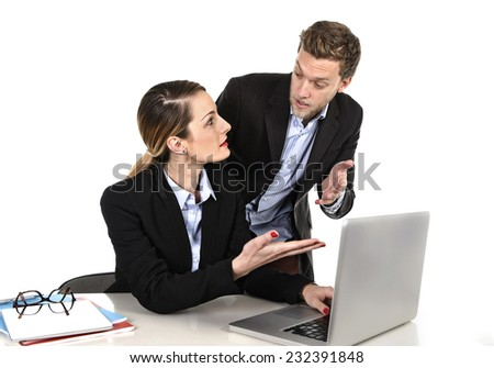 young attractive businesswoman working at computer laptop in office arguing with work colleague in stress fighting against each other in front of computer laptop in hard and annoying job relationship - stock photo