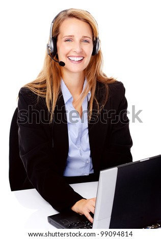 young attractive businesswoman working at her desk with a laptop and headset. happy and smiling - stock photo