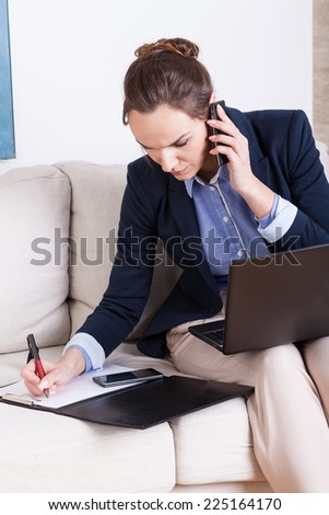 Young attractive businesswoman working at home, vertical - stock photo
