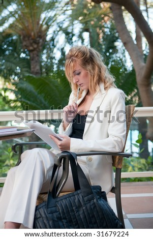 young attractive businesswoman working in a restaurant terrace