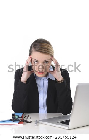 young attractive businesswoman working on office computer laptop sitting at office frustrated, overworked suffering stress, headache, depression and work problems - stock photo
