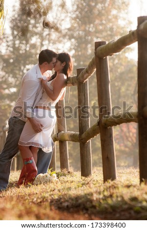Young attractive caucasian couple walking outdoors in autumn forest - stock photo