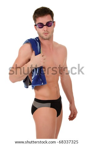 Young attractive caucasian man swimmer with goggles and towel on shoulder. Studio shot. White background