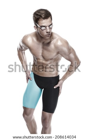 Young attractive caucasian man swimmer with goggles isolated over white background - stock photo