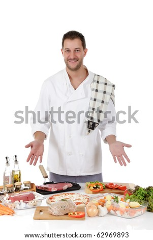 Young attractive chef caucasian male with uniform showing diversity of uncooked meals. Studio shot. White background