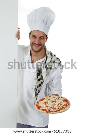 Young attractive chef male with hat and white uniform showing a pizza. Studio shot. White background.