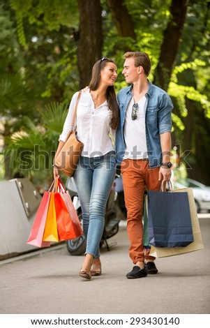 young attractive couple at shopping - stock photo
