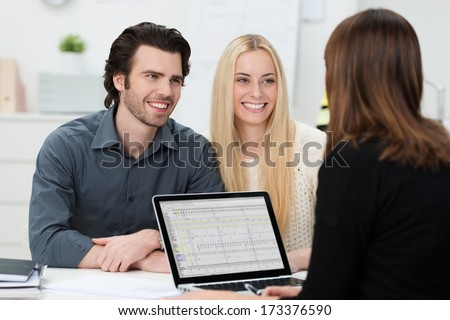 Young attractive couple during an interview at an office - stock photo