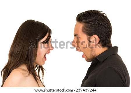 young attractive couple fighting screaming to each other isolated on white - stock photo