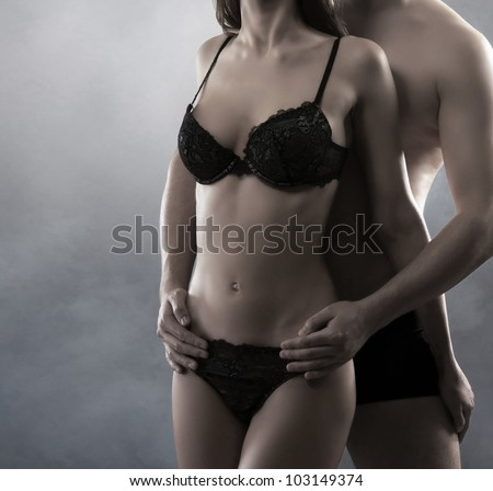 Young attractive couple in a twilight - stock photo